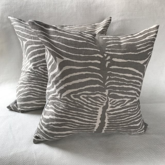 """Pair of 22"""" custom pillows fabricated with the iconic Brunschwig & Fils Le Zebre in Grey. Finished with a knife edge, grey..."""