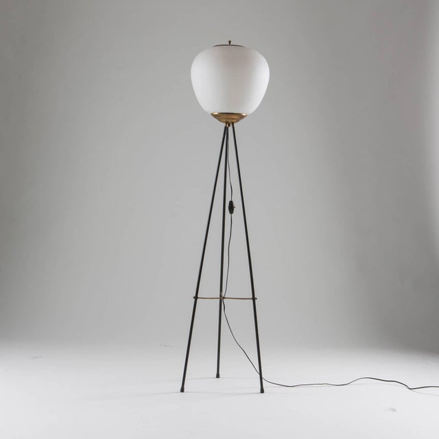 Beautiful Stilnovo floor lamp. Metal frame with brass details and opaline glass shade.