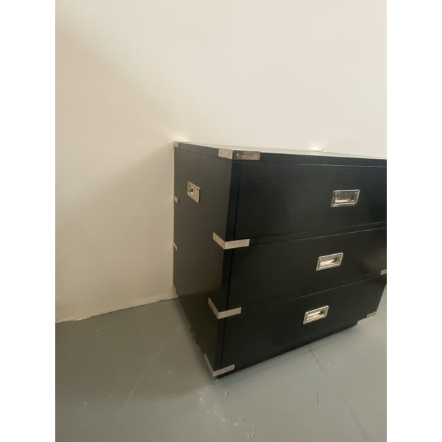 Ebony black wood with polished chrome hardware. Item made by Lexington. Great item. Can go into many room schemes.