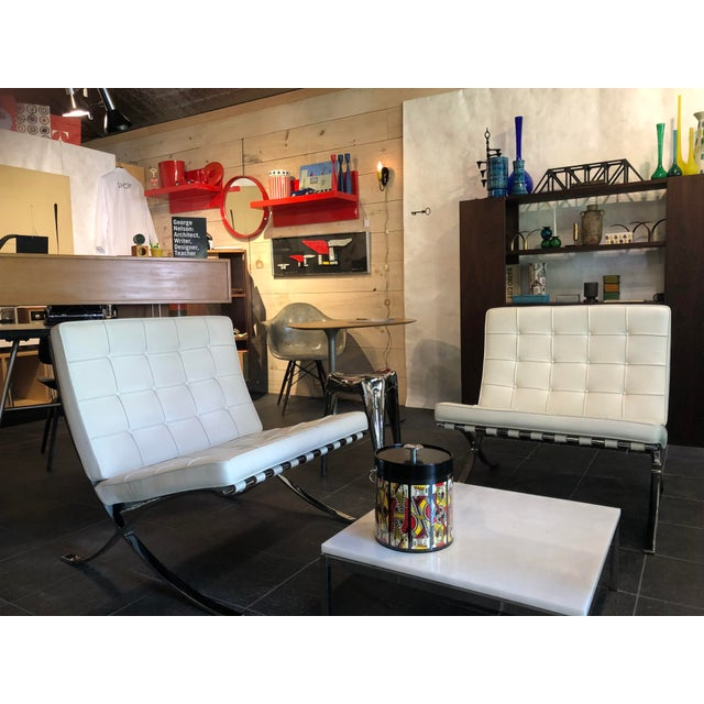 Barcelona Chairs with exposed chrome frame designed by Ludvig Mies van der Rohe with original Knoll Associates label.