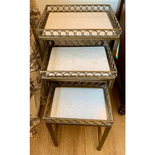 Iron-frame nesting tables with marble top (Set of 3). Very substantial with pretty circular detail.