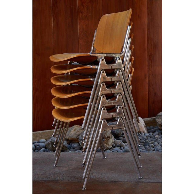 1960s Giancarlo Piretti Stackable chairs for Castelli. Executed in polished aluminum and wood. A quintessentially 1960s...