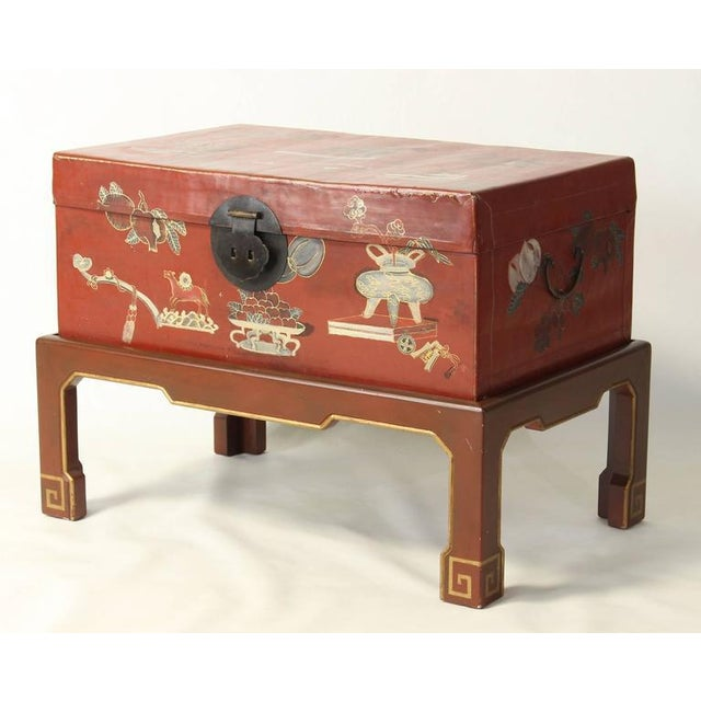 A lovely red parchment hand-painted Chinese trunk on later custom-made stand.