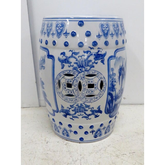 Porcelain Chinese garden seat while with blue floral decoration.