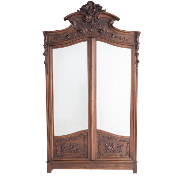 French Walnut Armoire In the Louis XV taste, c. early 1800's. Bedroom Pieces are available. The carved shaped crest with...