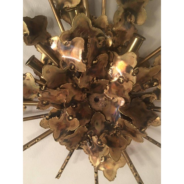 Vintage Brutalist torch cut wall light sconce by Tom Greene for Feldman. This has a plug but can also be hard wired. Holds...