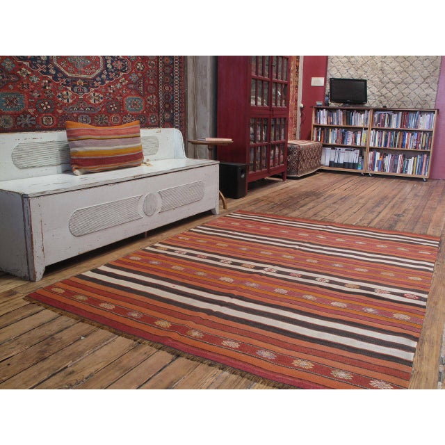 A handsome old tribal flat-weave from Western Turkey, woven with alternating bands of color and decorated with...
