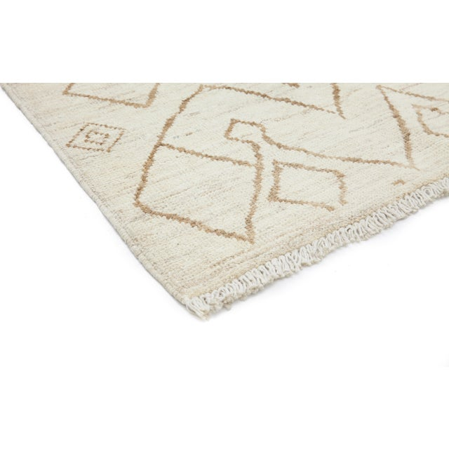 Made in Pakistan. Inspired by the weavings of the Beni Ourain nomadic tribe in Morocco's snowy Atlas Mountains, this...