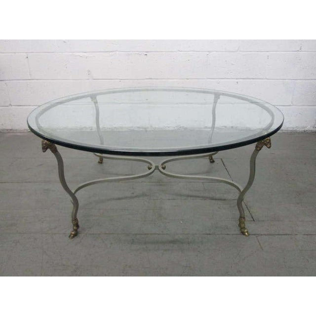 Italian steel & brass coffee table with ram's head and hoof feet.