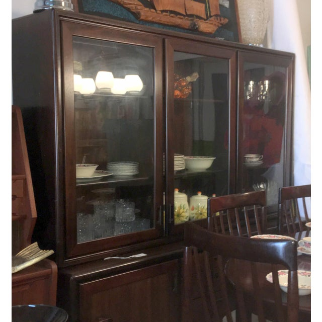 "This lighted Rosewood Cabinet is two separate pieces. The upper piece measures 41"" Tall, 701/8"" Wide and has a depth of..."