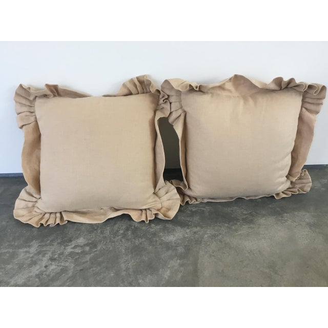 """Pair of Embroidered linen pillows with light gold crest embroidery. 3"""" ruffle filled with down and zipper."""