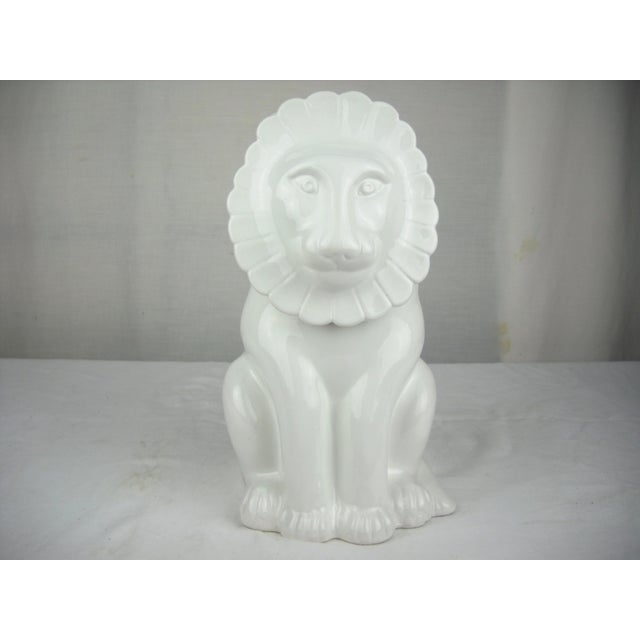 """1970's vintage white ceramic lion covered canister with a high-glaze. Mark on base reads, """"Made In Italy""""."""