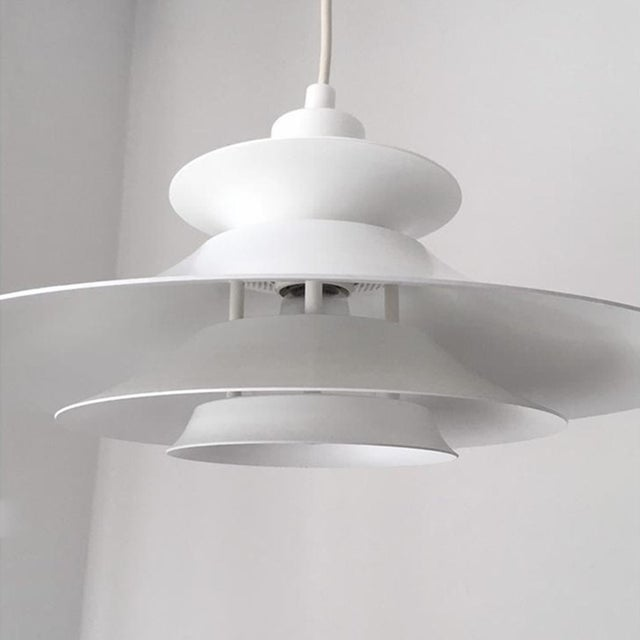 A beautiful vintage Danish Mid-Century pendant light by JEKA. The pendant is very solid with an exceptional build quality....