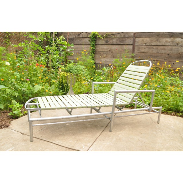 Mid-century outdoor chaise longue in aluminum. It has a matching set of 3 outdoor armchairs listed in our store front. The...