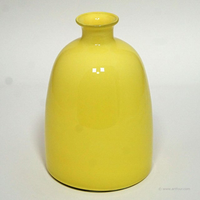 a colorful bright yellow glass vase manufactured by the muranese glassmakers of gino cenedese in the 60ties. original...