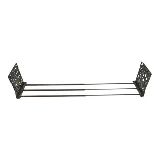Ornate Extending Metal Bookend For Sale