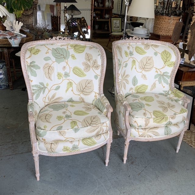 great pair of French style Begere chairs with great form! These chairs have a leaf design upholstery and decorative molding.
