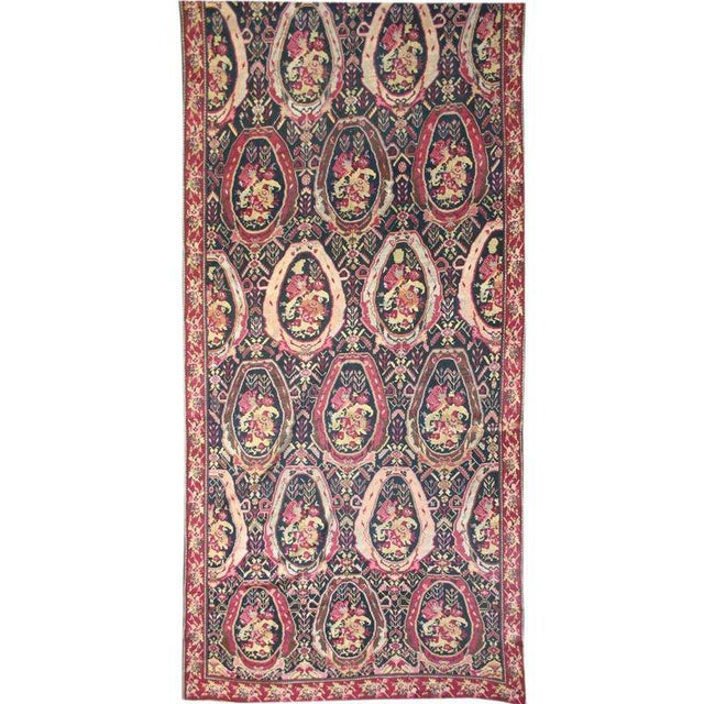 This long oversized Karabagh carpet demonstrates the fascination in the Near East with French design in the late 19th...