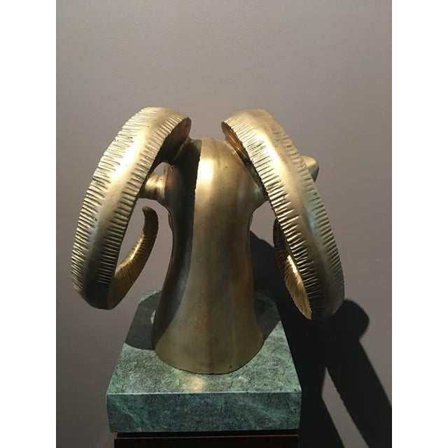 This substantial brass bust of a ram is mounted on a green marble base to make an attractive presentation, circa 1960s....