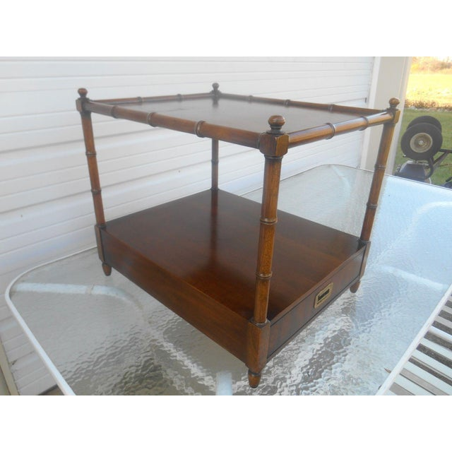 Mid-century modern Henredon Asian Campaign Style Faux Bamboo Nightstand / End Table in walnut solids and veneers. Item:...