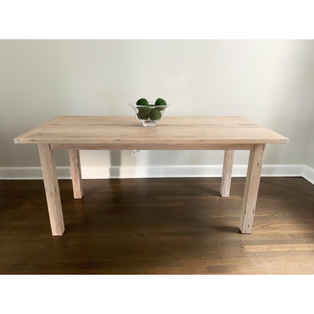 This one-of-a-kind reclaimed wood dining table was custom made by an experienced local furniture-maker. The wood is from...