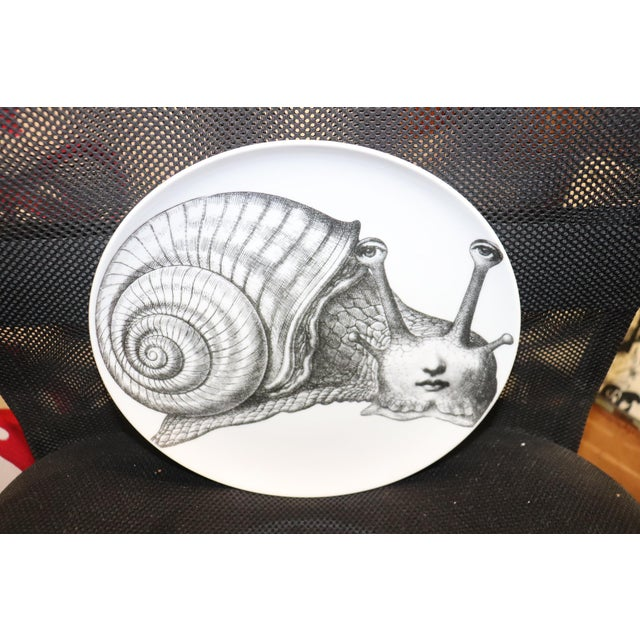 A lovely plate by Fornasetti. This is not a reproduction.