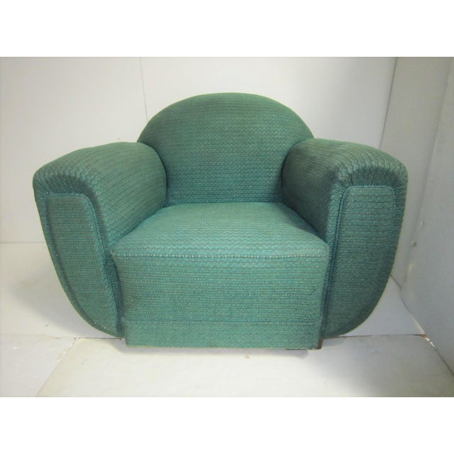 """A pair of very comfortable oversized French Art Deco """"Elephant"""" armchairs with padded balloon arms, curved back rest,..."""