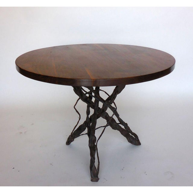 Custom hand-forged iron vine base with walnut top. Top has a clean crisp edge and natural finish. Can be made in any size....