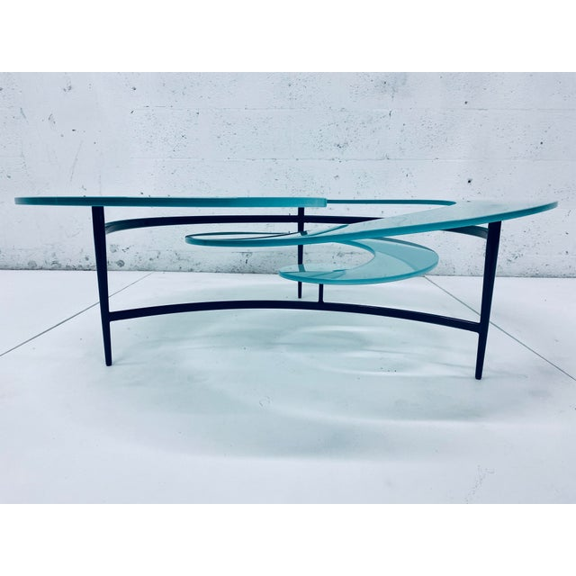 Frosted aqua marine blue-green glass spiral coffee table top on gunmetal grey steel base by Giorgio Cattelan for Cattelan...