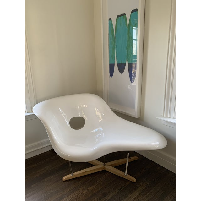 The chair was created using fiberglass for the shell and an oak base and chrome legs. The chaise conforms to the body in...