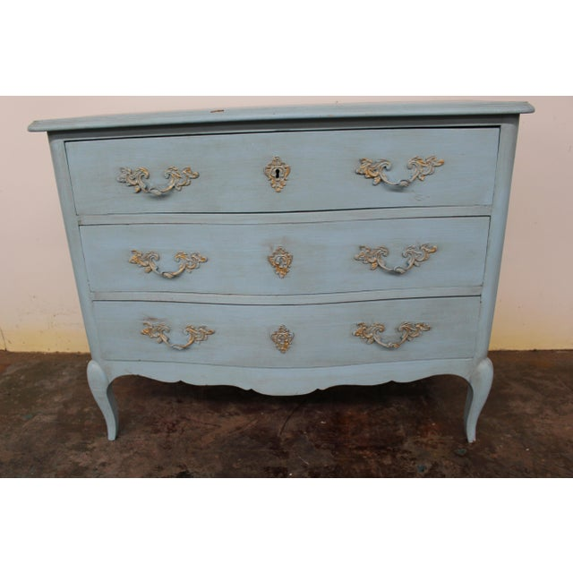 19th century vintage commode with a naturally distressed blue coat and bronze hardware. The Louis XV style inspired...