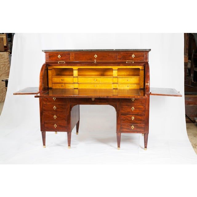 A very special, stamped and signed, freestanding mahogany cylinder bureau in the manner of Godefroy Dester (maitre 1774)....