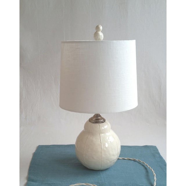 Finials have an original, organic shape that was hand formed in clay. The look is sculpted look with a wabi-sabi...