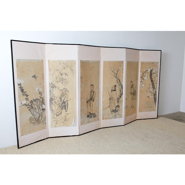 Meiji period Korean six-panel screen depicting legendary Chinese figures on individual panels with birds and blossoming...