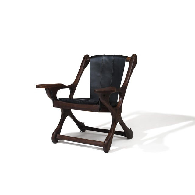 Don Shoemaker rosewood Swinger Chair handcrafted in Mexico, late 1950's. Newly restored and upholstered in black leather.