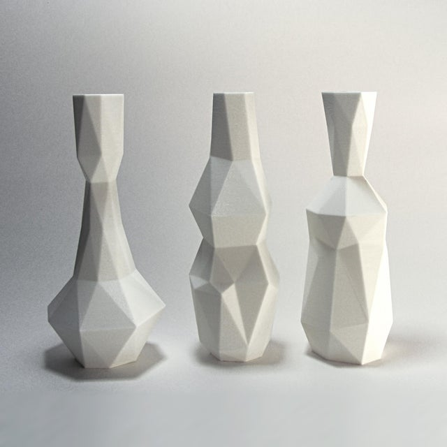 A set of 3 plastic vases of identical heights. The irregular polygon forms were inspired by the painting technique called...