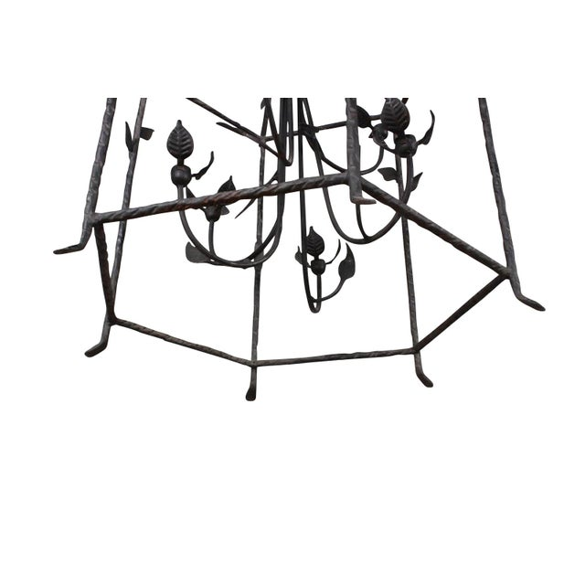 "Whimsical wrought iron Giacometti inspired hanging lantern. Size: 33 1/2 "" H x 23 1/2 "" W x 19"" D"