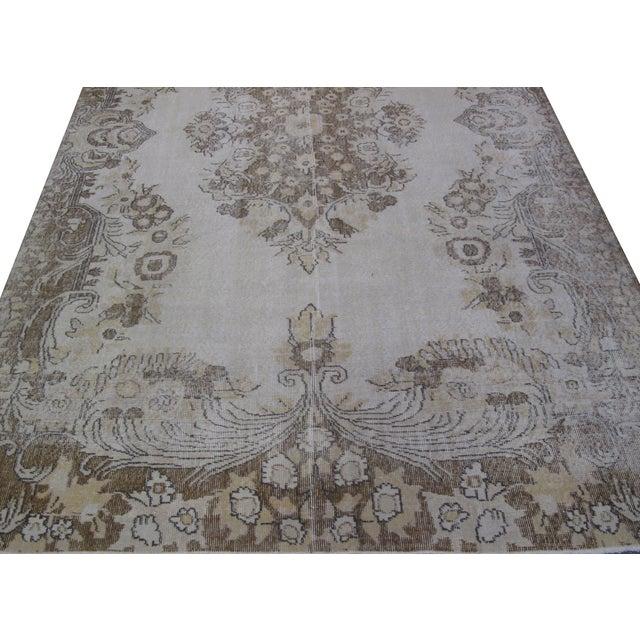 Vintage Distressed handmade Turkish rug.