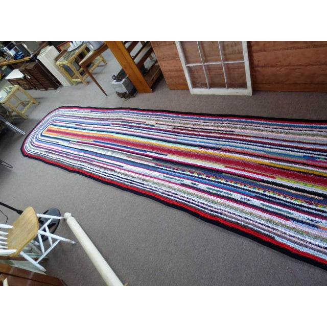 Amazing braided rag rug over 20 feet long! Excellent condition.