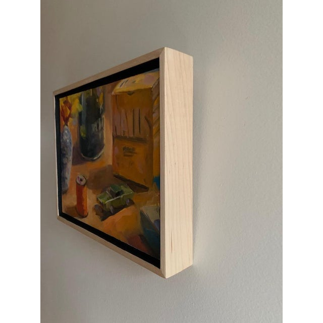 Still Life arrangement in the studio with orange thread, matchbox car, a box of nails, flower vase and Morton's salt. Oil...