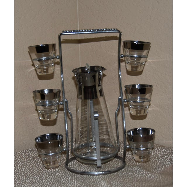 1950s martini cocktail set - a tall pitcher & six cordial glasses, all within a sparkly chromed steel display carrier. All...