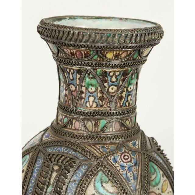 Antique Moroccan ceramic vase from Fez. Moorish style handcrafted vase adorned with fine filigree silver nickel work, with...