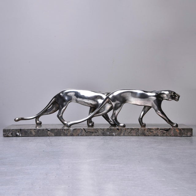 Circa 1930s statue of two sleek panthers. Unsigned, unmarked. Believed to be French. Appears to be cast metal with...