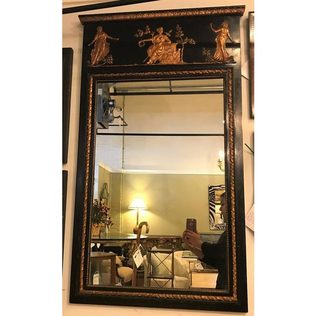 Hollywood Regency French Ebonized Neoclassical Style Wall or Console Mirror. The all over ebonized frame with gilt gold...