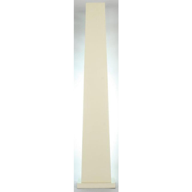 A stark obelisk display pedestal custom crafted for an interior bulb to provide a dramatic lighted effect when placed...