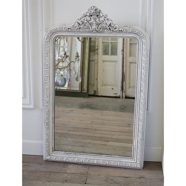 Beautiful Louis Phillipe mirror with an urn or roses and cherubs, painted in our soft oyster white with antique details....