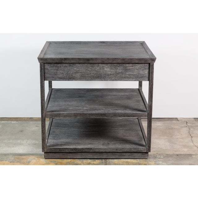 Paul Marra Two-Tier Nightstand finished in a distressed finish. One drawer, two shelves, banded top with mitered corners....