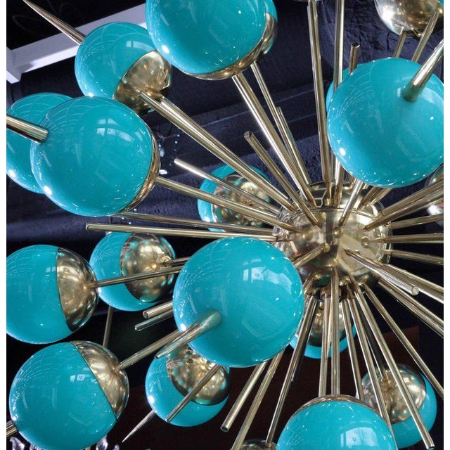Exceptional huge Tiffany turquoise Murano glass and brass Sputnik chandeliers. The chandeliers have a very impressing size...