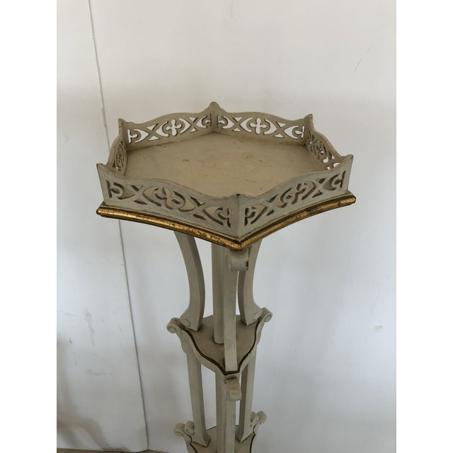A lovely pair of French vintage torchiere plant stands having cut out fretwork galleries, tripod legs with paw feet, very...