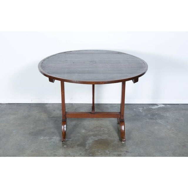 This French wine table with typical tilt-top dates back to the mid-1800s and features the original canvas top. Tables with...